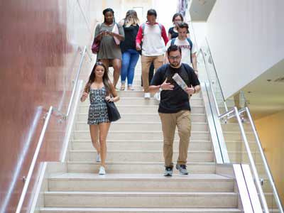 students walking down the steps of Beckman Hall